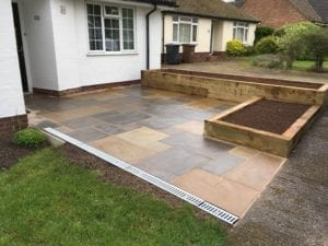 Installation of new patio and raised railway sleepers to create shrub border.