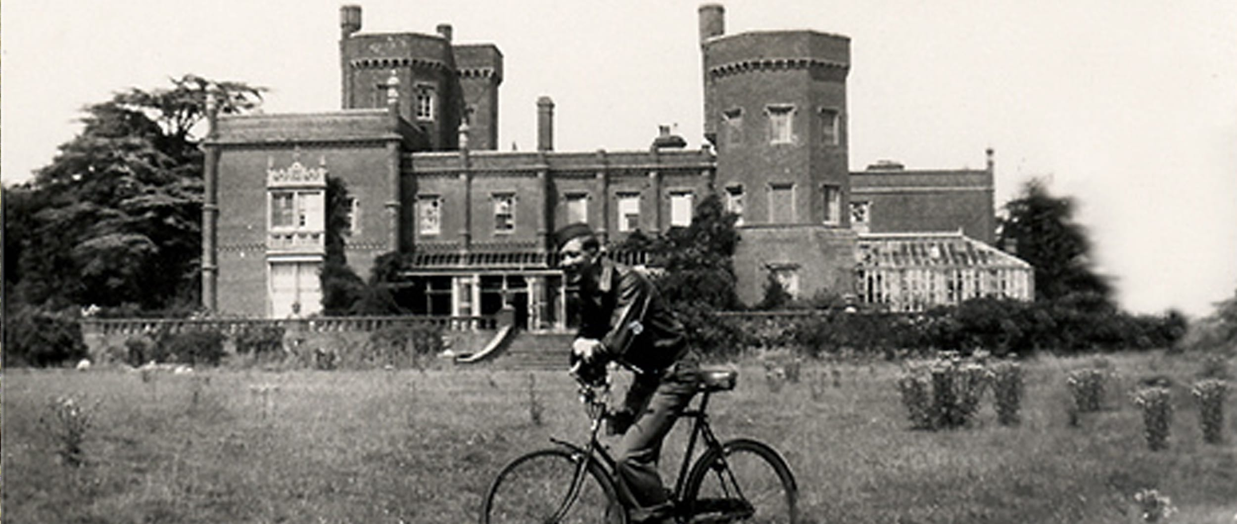 Soldier on bike in front of Rougham Hall